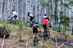 Group of riders up a mountain road during a race Stock Photos