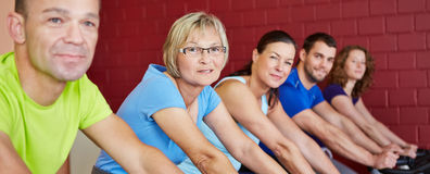 Group riding bikes in health club Royalty Free Stock Photos