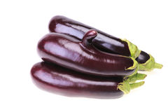 Group of ripe aubergine with finger Stock Photos