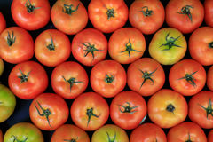 Group of ripe fresh red tomatoes on a market Royalty Free Stock Image