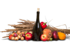 Group of ripe fruits and vegetables with bottles Stock Image
