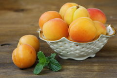 Group ripe juicy fruit apricot on a wooden table Stock Image