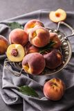 A group a ripe peaches in rustic bowl Royalty Free Stock Photo