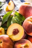 A group a ripe peaches on wooden table Royalty Free Stock Photo