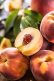 A group a ripe peaches on wooden table Royalty Free Stock Photos
