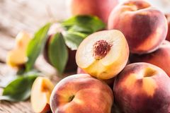 A group a ripe peaches on wooden table Stock Images