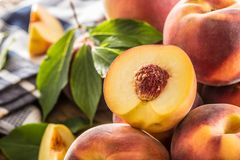 A group a ripe peaches on wooden table Royalty Free Stock Image