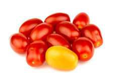 Group of ripe red and gold grape tomatoes isolated against white Royalty Free Stock Images