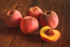 Group of ripe red peaches. On wooden background Royalty Free Stock Photography