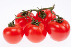 Group of ripe red tomatoes isolated on white background Stock Photo