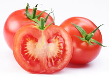 Group of ripe tomatoes and its half Stock Photography