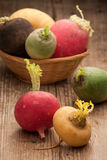 Group ripe variegated radishes in woven bowl Royalty Free Stock Photography