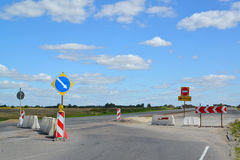 Group of road signs, barriers and road detour Stock Photo