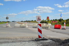 Group of road signs, barriers and road detour Stock Photos