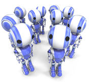 Group of robotic men. A view of a group of blue and white striped robotic men on a white background Stock Photography