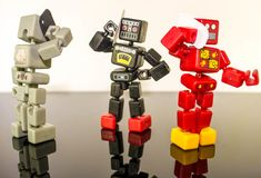 Time to Call. A group of robots all on their smart phones royalty free stock photos