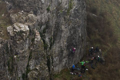 Group of rock climbers at Cheddar Gorge landscape. Team of climbers ascend cliff in Somerset, UK, in one of Britain`s most impressive areas of natural beauty royalty free stock photography
