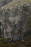 Group of rock climbers at Cheddar Gorge. Team of climbers ascend cliff in Somerset, UK, in one of Britain`s most impressive areas of natural beauty royalty free stock images