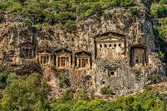 A group of rock cut tombs of ancient kings royalty free stock photo
