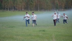 A group of rock musicians having fun running with the tools in a smoke-filled field. Funny shot. Friends having a good time together stock video
