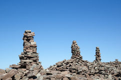 Group of rock piles at a clear blue sky Stock Photos