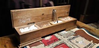A group of rock sugar. Brown sugar cubes in wooden box . Various tea and various kind of sugar on wooden table. Rock candy sugar in wooden box. Brown sugar cubes royalty free stock image