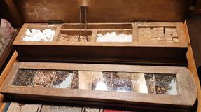 A group of rock sugar. Brown sugar cubes in wooden box . Various tea and various kind of sugar on wooden table. Rock candy sugar in wooden box. Brown sugar cubes stock image