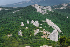 Group rocks in the mountains in the forest. The temple of the su. Summer mountain landscape: 681m Ilyas-Kaya and Sun Temple. View of Cape Aya, near Laspi, Crimea Stock Images