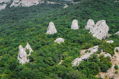Group rocks in the mountains in the forest. The temple of the su. N. The mysterious place of power in the Crimea Royalty Free Stock Images