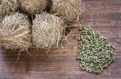 Group of Rodent food and hay on grunge wooden background. Stock Photo
