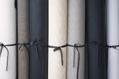 Roll of fabric. Group roll of fabric stack in the factory royalty free stock image