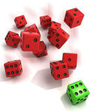 Group rolling red dices with one winning green Royalty Free Stock Photos