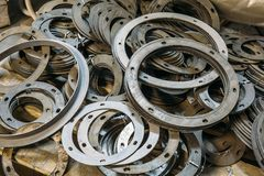 Group of round spacers pats for machine-tool used in metalworking factory Royalty Free Stock Photos