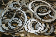 Group of round spacers pats for machine-tool used in metalworking factory Stock Image