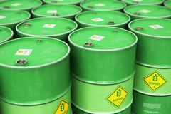 Group of rows of green stacked biofuel drums in storage warehous. Creative abstract ecology, alternative sustainable energy and environment protection saving Stock Photo