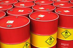 Group of rows of red stacked oil drums in storage warehouse Stock Photo