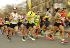 Group of runners in Barcelona streets. Running during Barcelona Half Marathon in Barcelona on February 15, 2015 in Barcelona, Spain Royalty Free Stock Photography