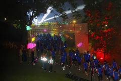 Group of runners in blue dresses, laser show Royalty Free Stock Photo
