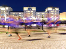 Group of runners in blue dresses, motion blur Stock Photo