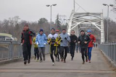 Group of runners on the bridge Royalty Free Stock Photo