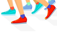 Group of runners. Colorful illustration of a group of runners (lower leg and feet only)  with red, pale green and blue track shoes but with sports socks Royalty Free Stock Image