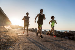 Group of runners exercising outdoors together for marathon Stock Photo