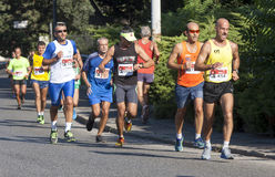 Group of runners on the road Royalty Free Stock Photos