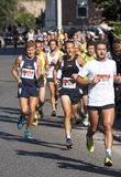 Group of runners on the road Royalty Free Stock Image