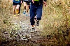 Group runners running uphill Stock Photos