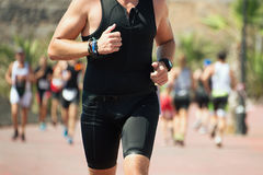 Group of runners in the triathlon. Event in bright sunlight Stock Photos