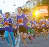 Group of running girls in blue dresses Stock Photo