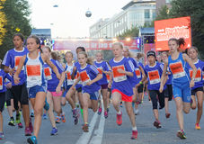 Group of running girls in blue dresses Royalty Free Stock Photo