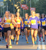 Group of running girls and boys Stock Photo