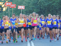 Group of running girls and boys Stock Images